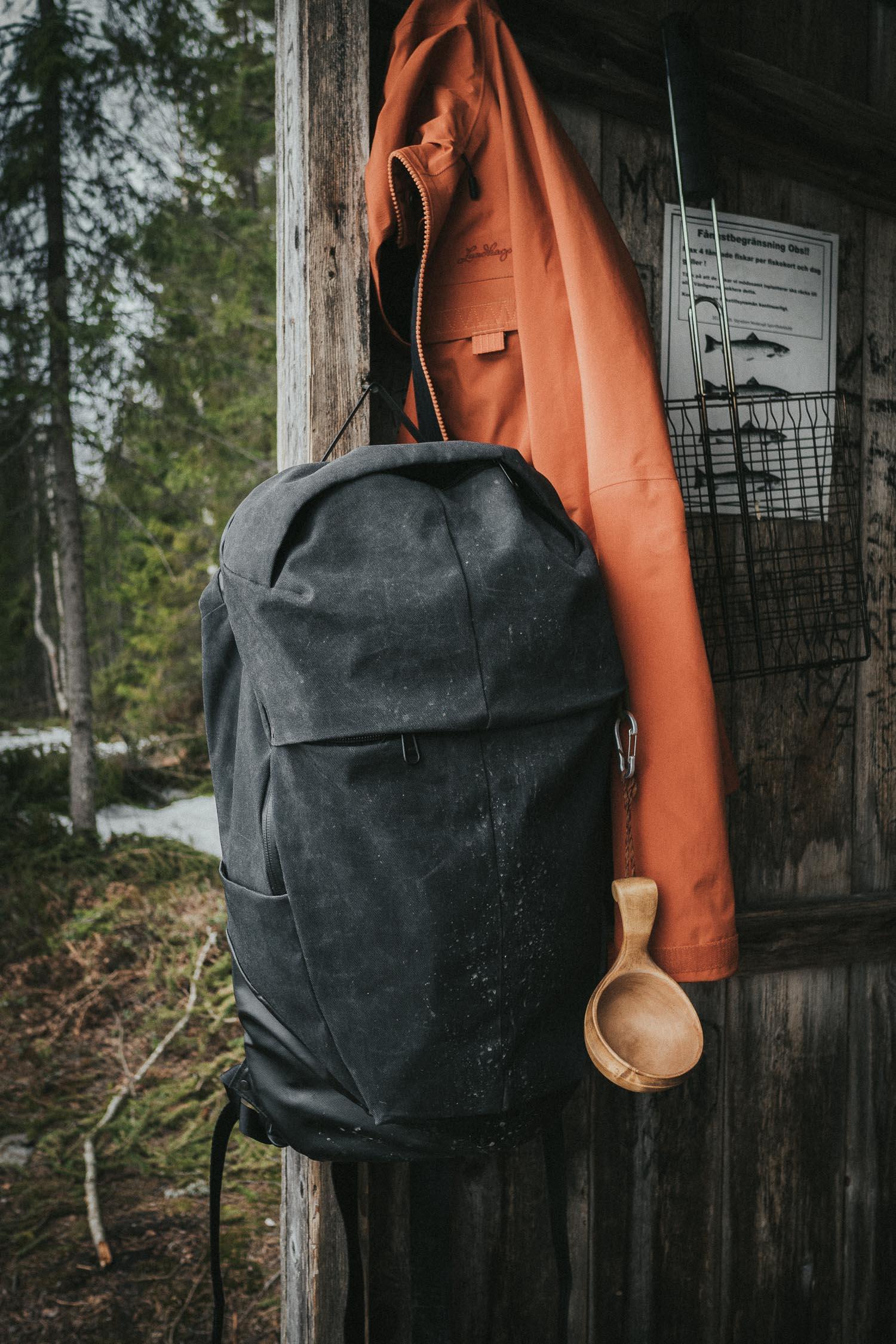 Backpack & jacket hanging in a shelter