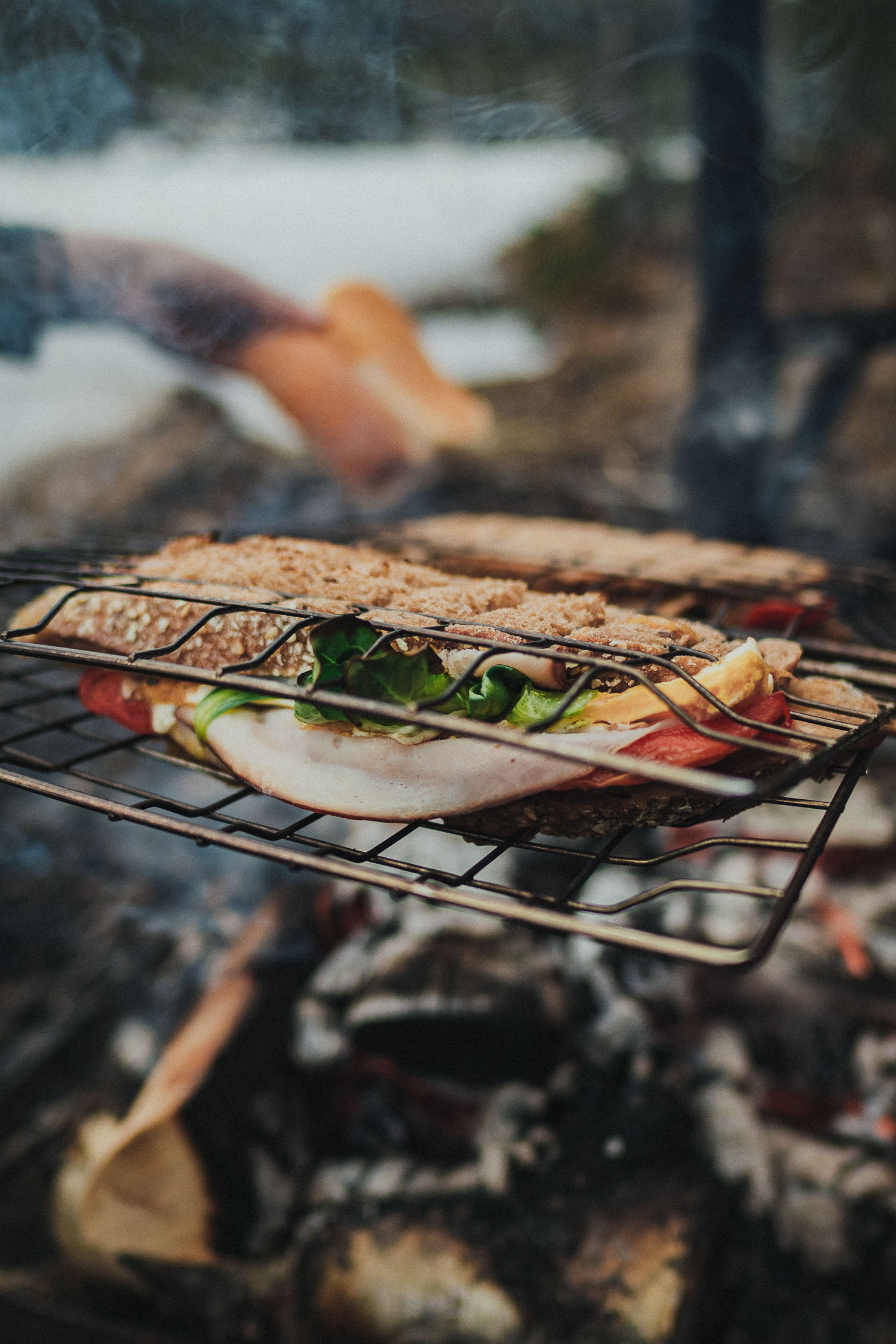 cooking sandwiches over open fire
