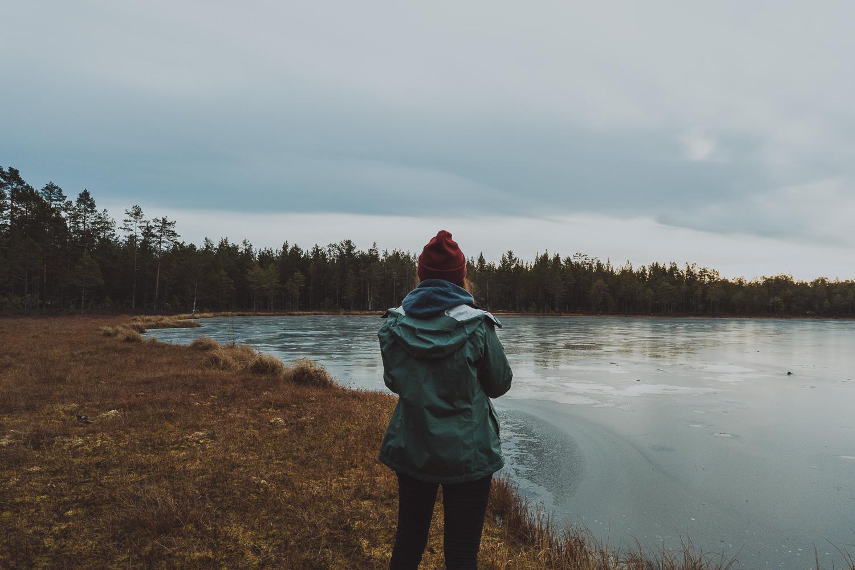 woman by a lake