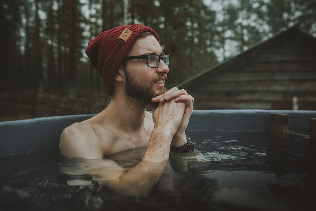 man in an outdoor hot tub