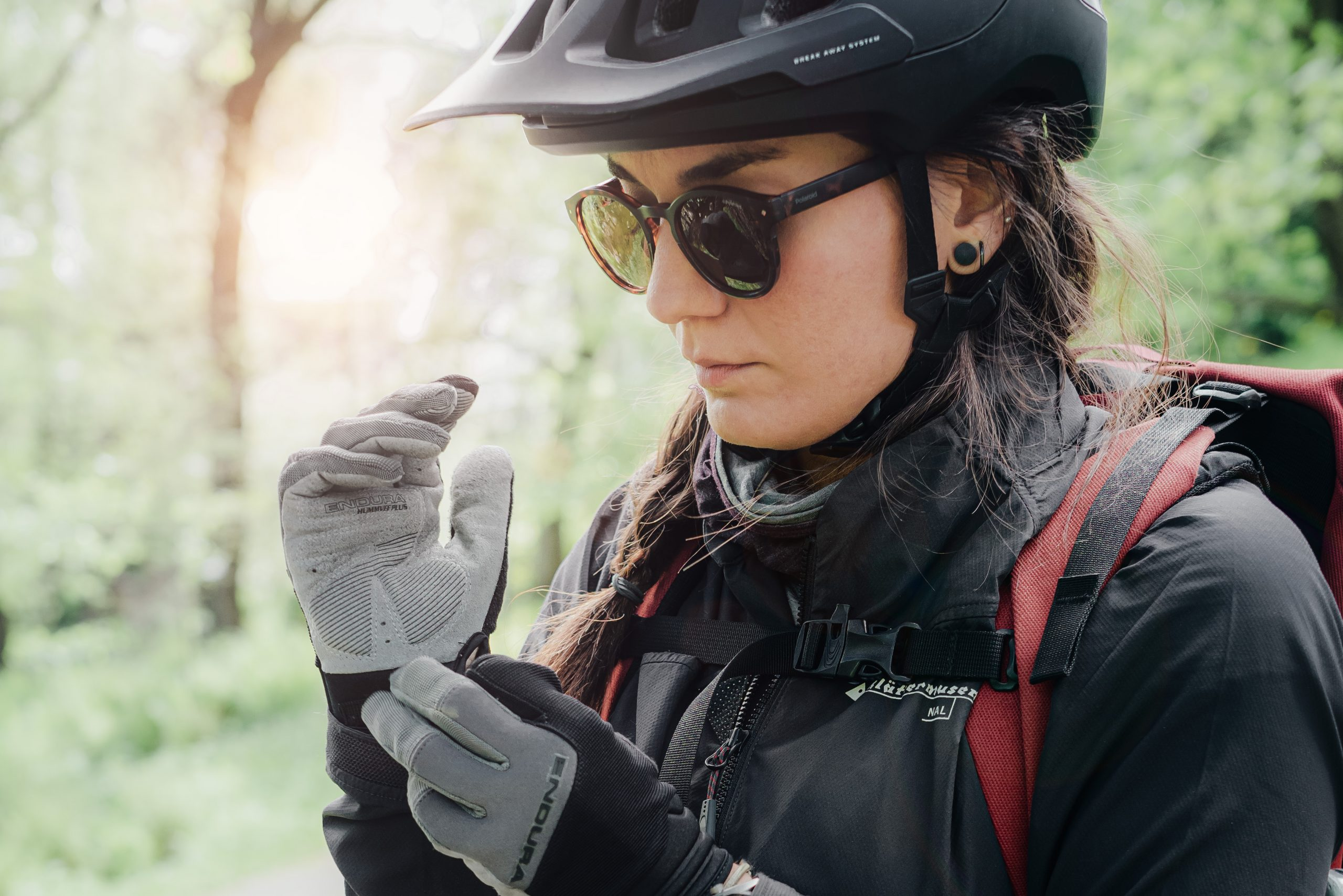female biker putting gloves on