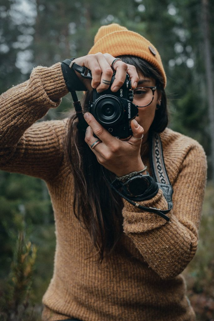 woman with an Olympus camera in the forest